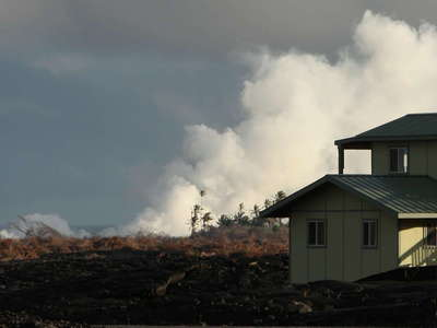 Kalapana  |  Homes on lava and steam plume
