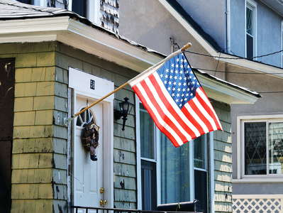 Staten Island  |  Residential building with US flag